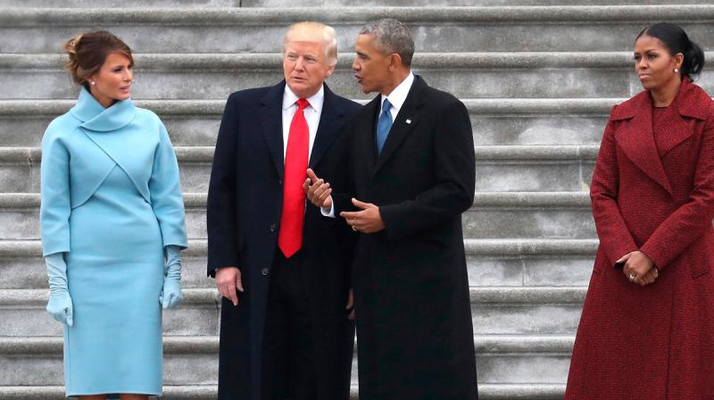 Barack and Michelle Obama indulged in some romantic public display of affection on Twitter while Melanie and Trump's timeline remained cold. (Photo: AP)