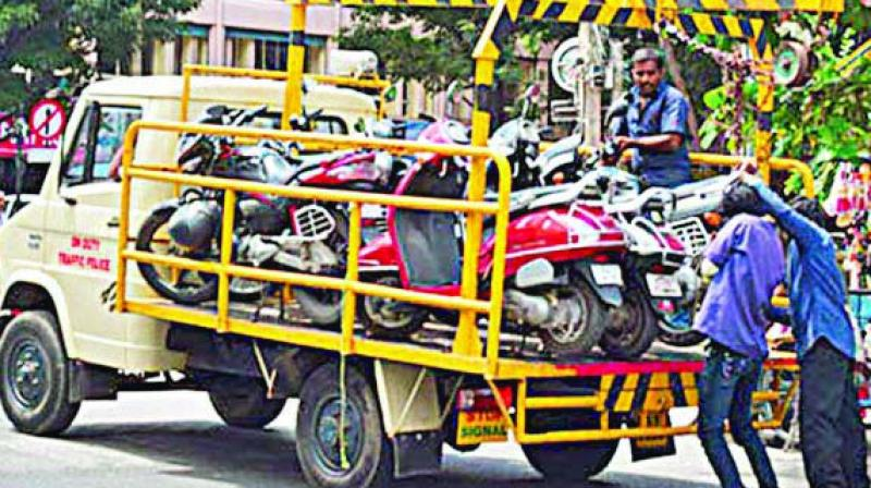 Representational image of two-wheelers being towed.