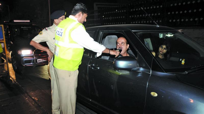 Cops checking vehicle drivers for drunken driving.