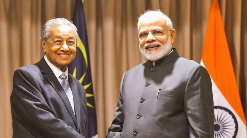 PM Modi met the Malaysian Prime Minister on the sidelines of the fifth meeting of the Eastern Economic Forum (EEF) held in the Russian Far East Region.  (Photo: MEA   Twitter)