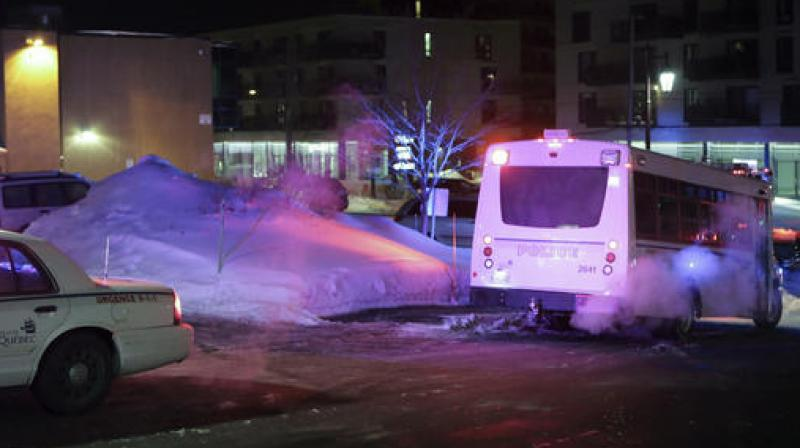 Police survey the scene after a deadly shooting at a mosque in Quebec City, Canada. (Photo: AP)
