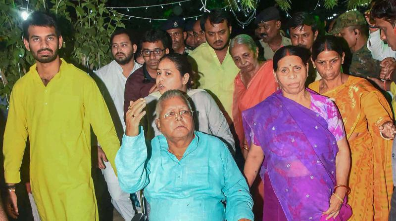 Former Bihar chief minister Rabri Devi receives RJD chief Lalu Prasad Yadav on his arrival in Patna. (Photo: PTI )