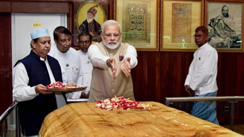 Modi visited the 'Mazar' of the emperor in Yangon and paid floral tributes. (Photo: PTI)