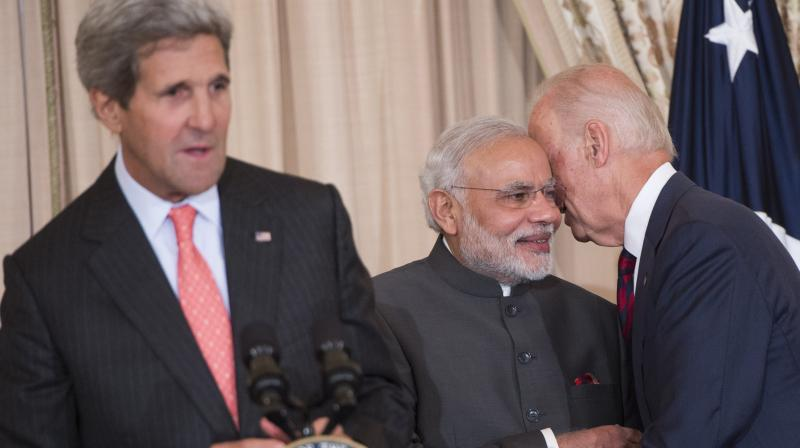 Biden and Modi committed that the US and India will work closely together to win the fight against the COVID-19 pandemic, renew their partnership on climate change, rebuild the global economy in a way that benefits the people of both countries. (File photo / Saul LOEB / AFP)