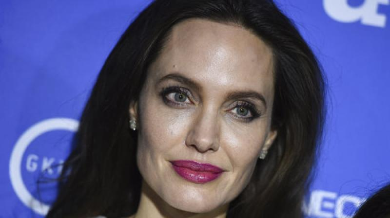 Executive producer Angelina Jolie arrives at the Los Angeles premiere of