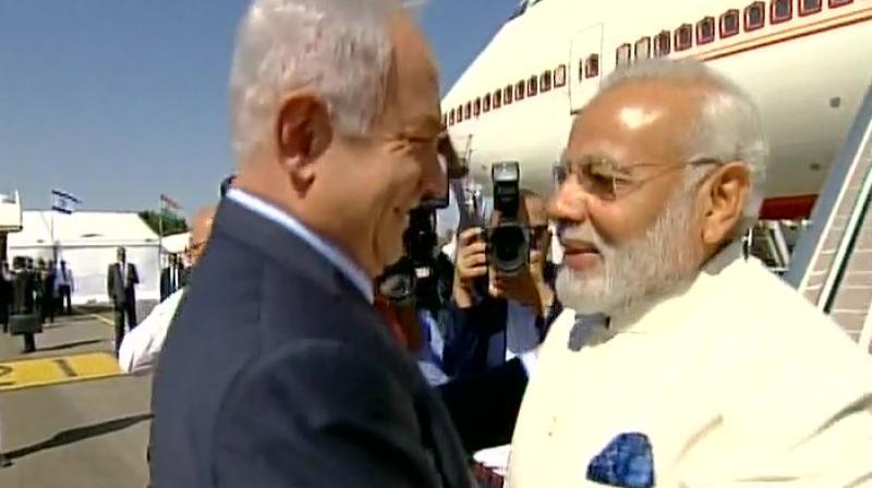 Prime Minister Benjamin Netanyahu welcomes Prime Minster Narendra Modi at Tel Aviv's Ben Gurion airport. (Photo: Twitter   ANI)