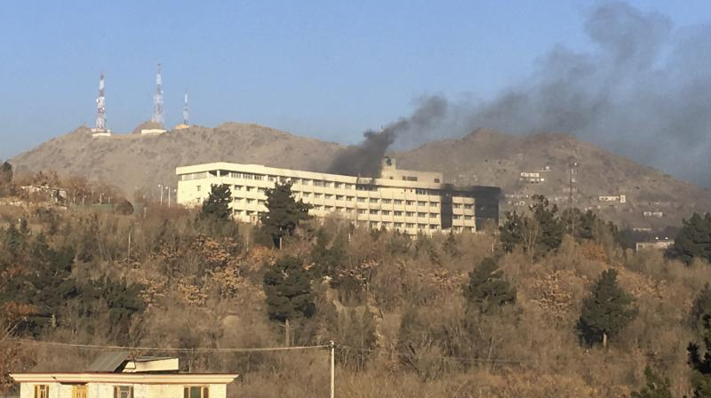 Smokes rises from the Intercontinental Hotel after an attack in Kabul, Afghanistan, Sunday, Jan. 21, 2018. Gunmen stormed the hotel in the Afghan capital on Saturday evening, triggering a shootout with security forces, officials said. (AP Photo)