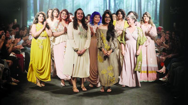 Rixi Bhatia surrounded by her models at the end of the show