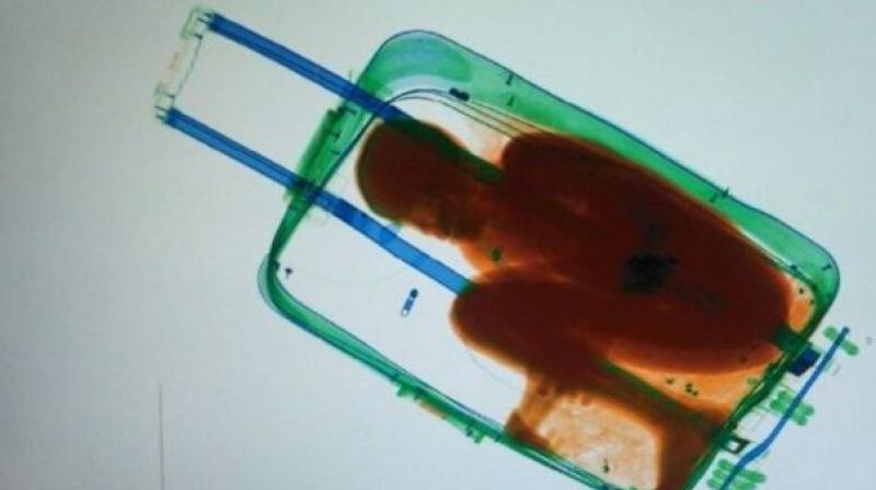 On May 7, 2015, Spanish police noticed a young Moroccan woman dragging what looked like a heavy suitcase across the border with Ceuta.  When they put the suitcase through an X-ray machine they were shocked to see the silhouette of a child curled up in foetal position. (Photo: AFP)
