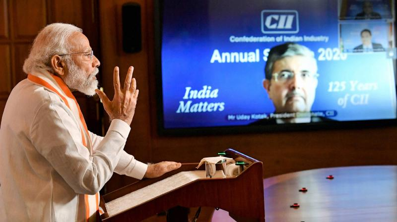Prime Minister Narendra Modi addresses the CII Annual Session-2020 via video conferencing, in New Delhi. PTI Photo
