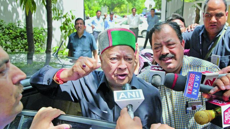 Himachal Pradesh chief minister Virbhadra Singh arrives to appear before the Enforcement Directorate in New Delhi. (Photo: PTI)