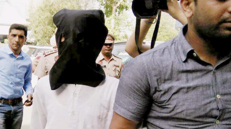 Suspected ISIS terrorist Ghaji Baba being produced in court in Jalandhar. (Photo: PTI)