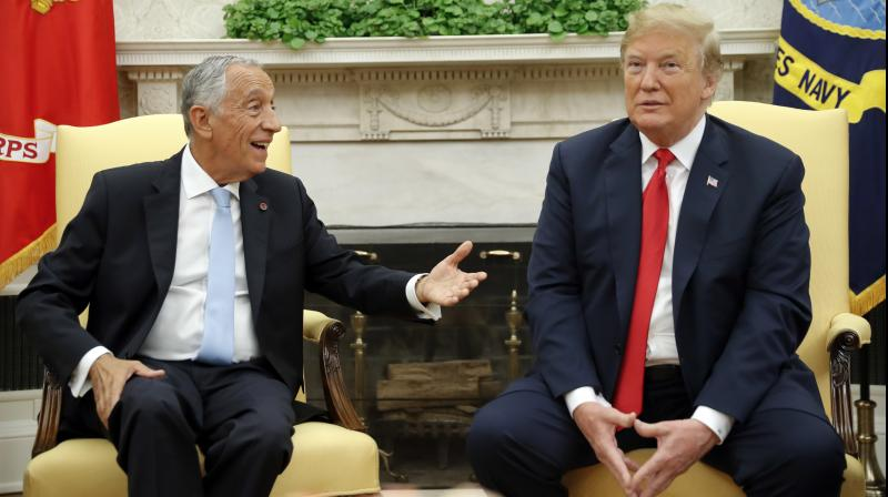 Trump greeted Rebelo de Sousa in the Oval Office and then turned to the cameras to offer his reaction to Supreme Court Justice Anthony Kennedy's retirement. (Photo: AP)