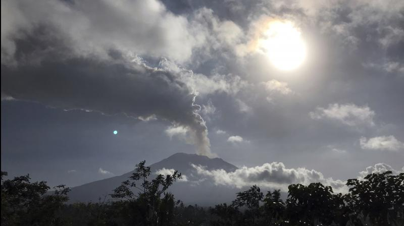 The airport was closed early Friday after a pilot flying overhead detected traces of volcanic ash as high as 23,000 feet. (Photo: AP)