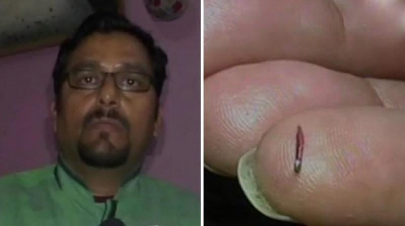 Haldwani: Artist Prakash Chandra Upadhyay holds the record of creating the world's smallest pencil, the 5mm long and 0.5mm wide pencil is made of wood and H.B. lead. (Photo: ANI/ Twitter)