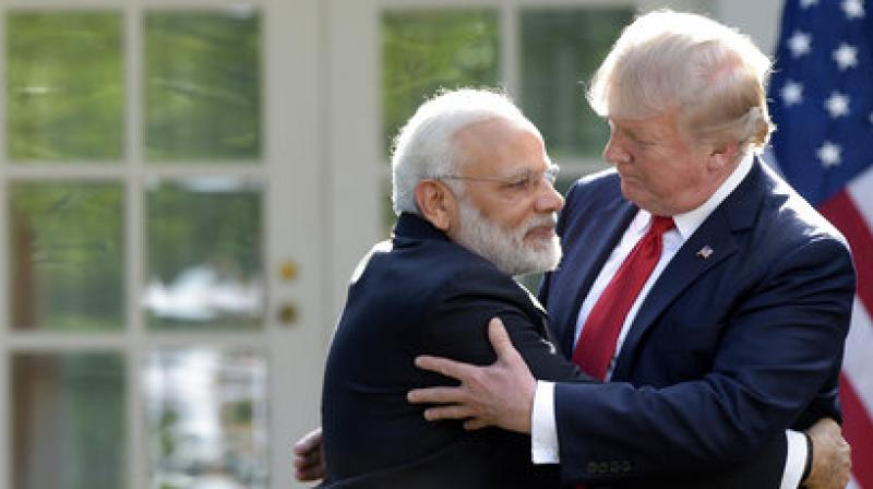 Prime Minister Narendra Modi gives bear hug to his counterpart US President Donald Trump (Photo: AP)