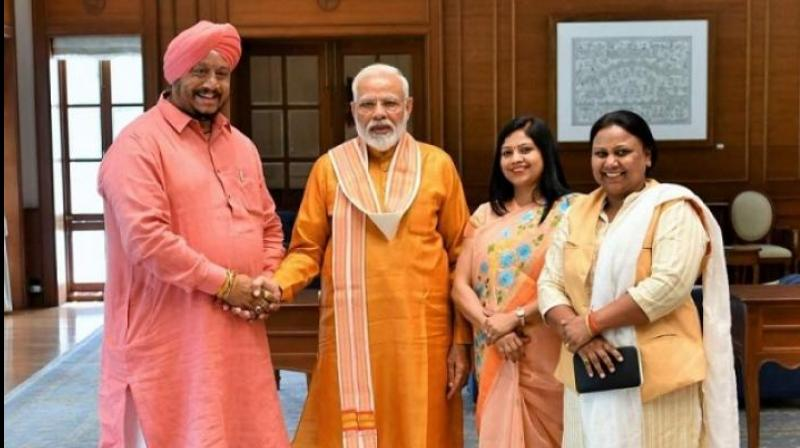 Newly elected North Delhi Municipal Corporation Avtar Singh greeting Prime Minister Narendra Modi. (Photo: BJP   Twitter)