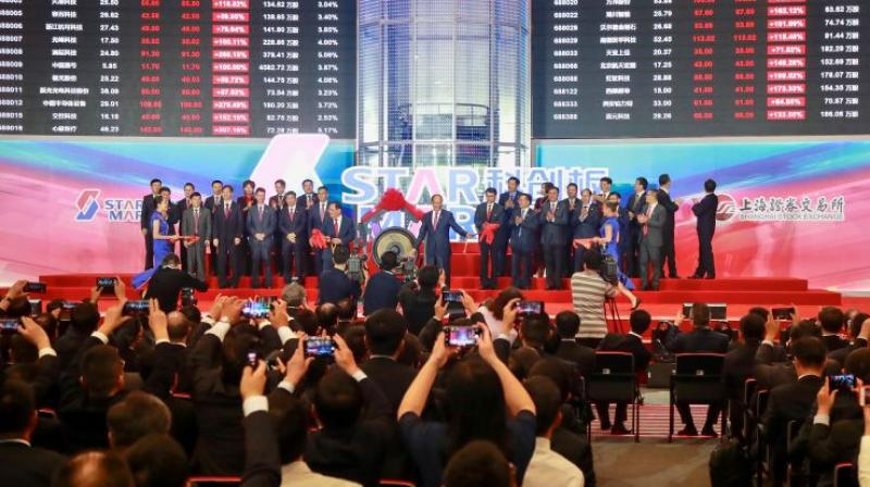 People take pictures during an opening ceremony of the Shanghai Stock Exchange's Sci-Tech Innovation Board or STAR Market in Shanghai on July 22, 2019. (Photo: AP)