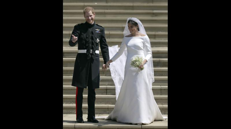 Meghan Markle and Britain's Prince Harry stand on the steps of St George's Chapel at Windsor Castle following their wedding in Windsor, near London, England, Saturday, May 19, 2018. (Photo: AP)