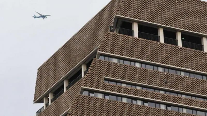 The boy fell from there onto a fifth floor roof and was airlifted to hospital by helicopter. (Photo: AFP)