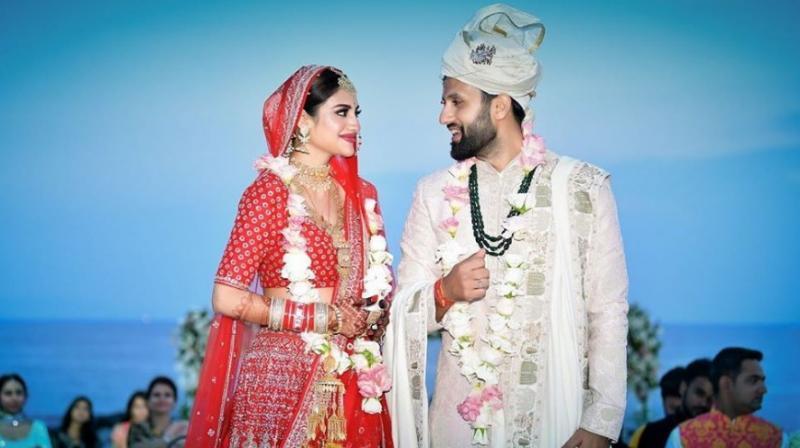 Nusrat wore a lehenga designed by fashion guru Sabyasachi Mukherjee. Nikhil's beau also wore a dress from Sabaysachi's stable. (Photo: Instagram)