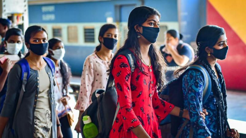 Passengers wearing masks in wake of coronavirus pandemic walk inside Bengaluru City Railway Station, on March 16, 2020. (PTI Photo)