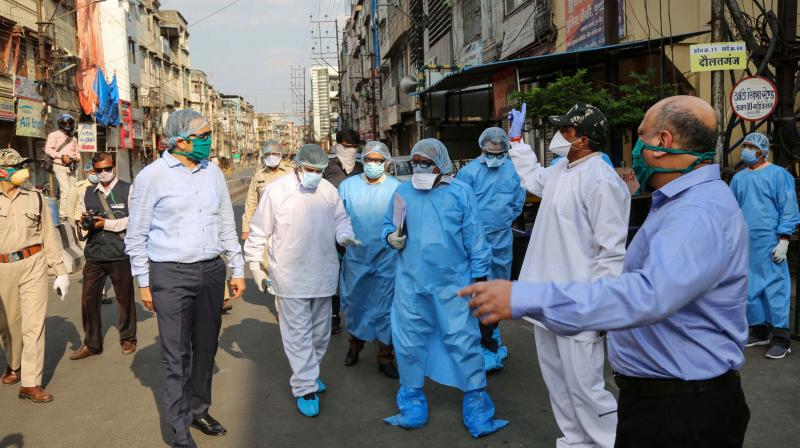 The divisional commissioner of Indore, Akash Tripathi, visits the Taat Patti Bakhal locality where health workers were attacked by local people last week. (PTI)