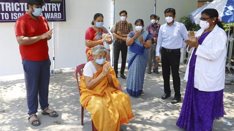 Staf cheer as a formerly COVID-19 positive patient is discharged after being quarantined at the Kilpauk Medical College Hospital in Chennai on Saturday, April 11, 2020. (PTI)