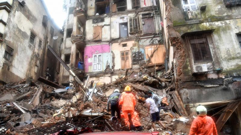 Rescue team check debris at the site of building collapse. — Photo: Rajesh Jadhav