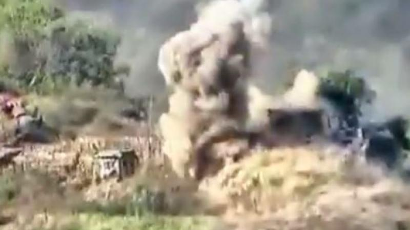 The 22-second video released by the Indian Army showed concrete structures being reduced to rubble amid plumes of smoke and balls of fire. (Photo: Videograb)