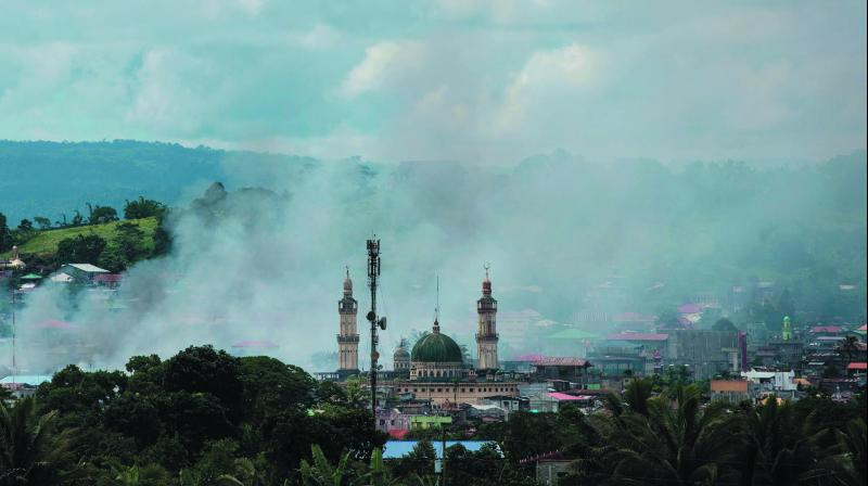 Smoke rises after aerial bombings by Philippine Air Force planes on Islamist militant positions in Marawi, on the southern island of Mindanao. (Photo: AFP)