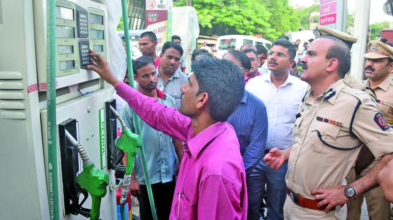 Thane police officials raided two petrol pumps on Saturday. (Photo: Deepak Kurkunde)
