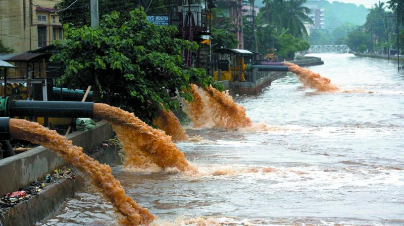 Motor pumps are used to divert flood water into a stream after rains in Guwahati Thursday. (Photo: PTI)