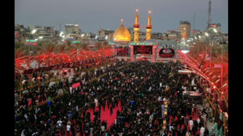 Shiite Muslim worshippers gather around the shrine of Imam Abbas during a Muharram procession in Karbala, Iraq, Wednesday, Aug. 18, 2021. Muharram, the first month of the Islamic calendar, is a month of mourning for Shiites in remembrance of the death of Hussein, the grandson of the Prophet Muhammad, at the Battle of Karbala in present-day Iraq in the 7th century.  — AP/PTI