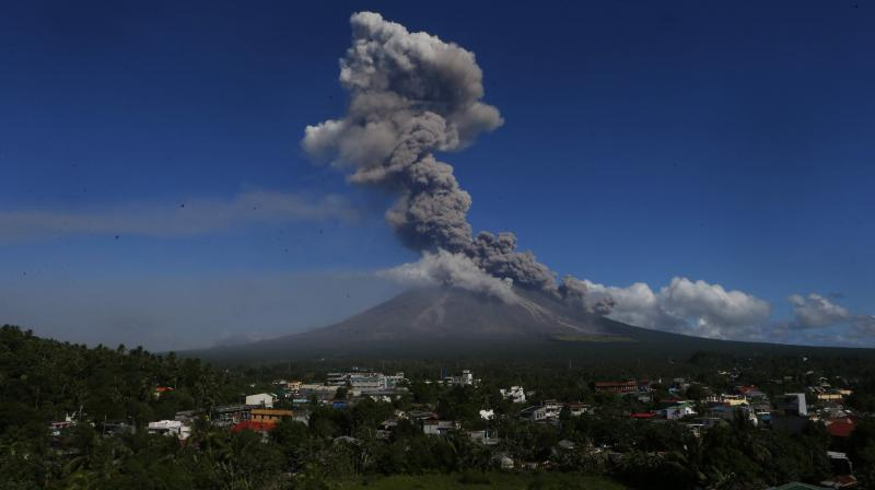 The eruptions have shrouded nearby villages in darkness and sent lava, rocks and debris cascading down Mayon's slopes toward the no-entry danger zone.(Photo: AP)