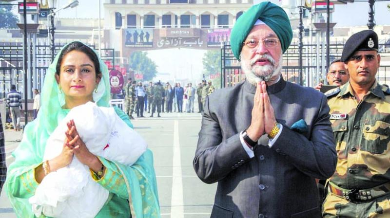 Union ministers Hardeep Singh Puri and Harsimrat Kaur Badal at Attari-Wagah border on Wednesday. (Photo: PTI)