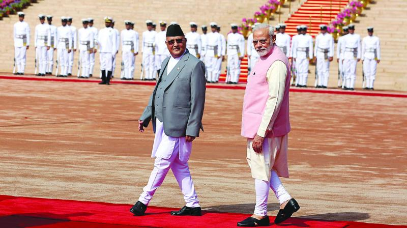 Prime Minister Narendra Modi walks with his Nepalese counterpart Khadga Prasad Sharma Oli during a ceremonial reception for the latter in New Delhi. (Photo: AP)