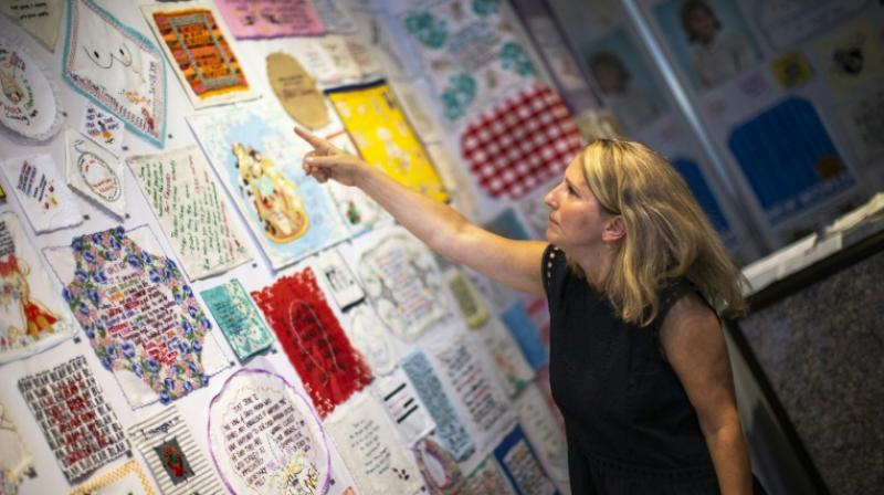 """The result is the """"Tiny Pricks Project,"""" a 900-strong collection of colorful needlework pieces featuring Trumpisms, many of which are currently on display at an exhibition in New York. (Photo: AFP)"""