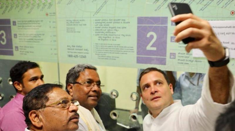 Congress president Rahul Gandhi bought the ticket at the station and took a selfie with the chief minister before boarding the jam-packed train. (Photo: Twitter/@INCIndia)