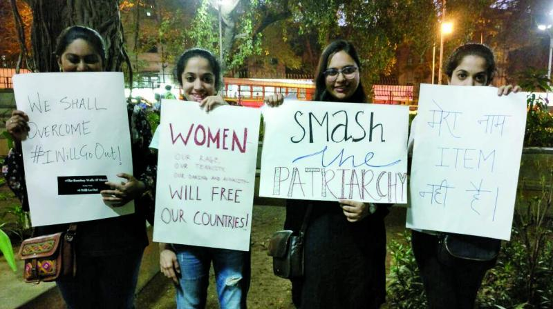 Women holding protest slogans. (Photo: Mallika Mahidhar)