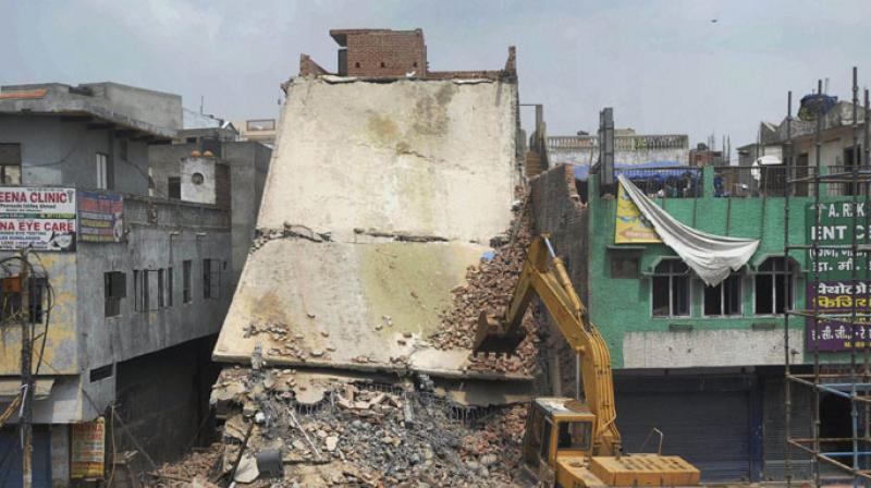 A 39-year-old man suffered injuries while three of his family members had a narrow escape when a four-storeyed building adjacent to their house collapsed in east Delhi's Shakarpur area. (Photo: Representational/PTI)