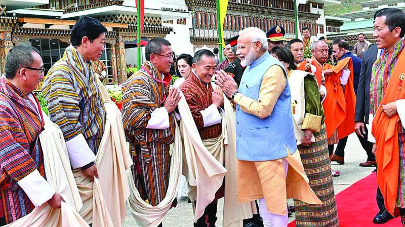 Prime Minister Narendra Modi is welcomed on his arrival at Paro Airport in Bhutan on Saturday. (Photo: PTI)