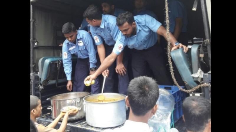 Indian Navy distributes breakfast to people in Parel area (Photo: ANI)