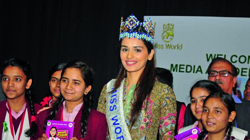 Miss World Manushi Chhillar with school girls during an event on menstrual hygiene in New Delhi on Tuesday. (Photo: Bunny Smith)