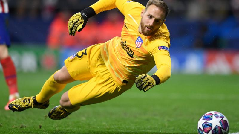 Atletico Madrid's Slovenian goalkeeper Jan Oblak dives for the ball during the UEFA Champions League round of 16 first-leg football match between Club Atletico de Madrid and Liverpool FC at the Wanda Metropolitano stadium in Madrid on February 18, 2020. (AFP)