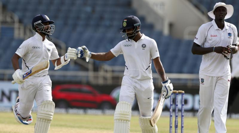 The in-form Ajinkya Rahane (64 not out) and Hanuma Vihari (53 not out) got India's second innings back on track after the top-four were dismissed for 57 runs. (Photo:AP)