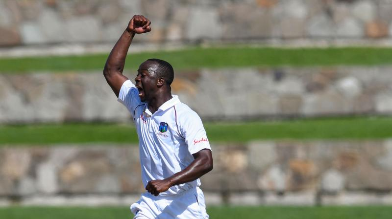 After dismissing opener Mayank Agarwal (5) before lunch on the third day of the second Test, Kemar Roach came out firing on all cylinders and removed KL Rahul and skipper Virat Kohli off successive balls to be on the verge of a hat-trick in India's second innings on Sunday. (Photo:AFP)