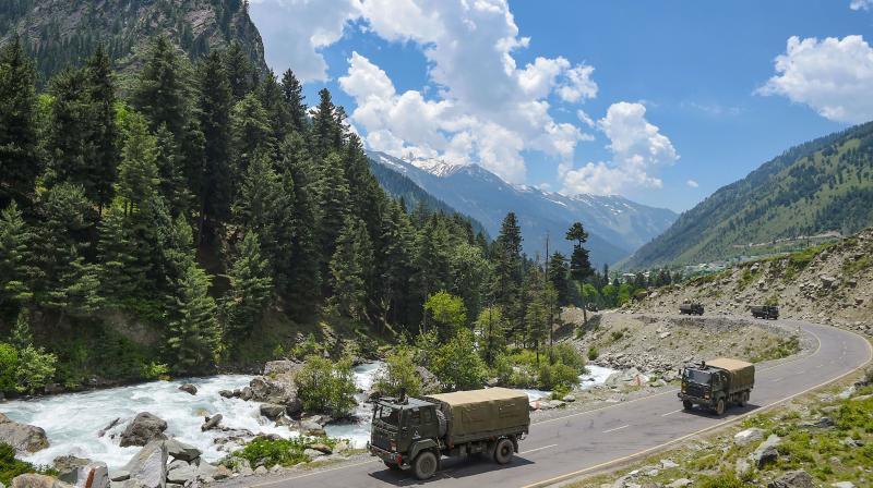 An army convoy moves along the Srinagar-Leh highway. PTI photo