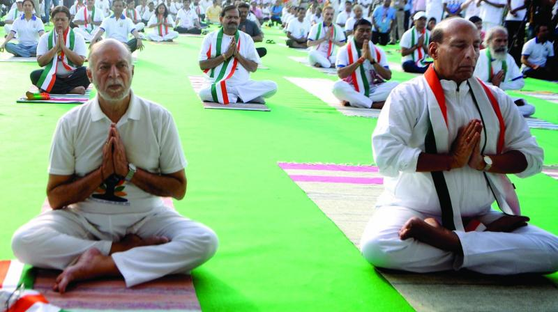 Delhiites participate in a yoga session on Rajpath in New Delhi on Friday to mark the International Day of Yoga. Defence minister Rajnath Singh and Delhi lieutenant-governor Anil Baijal during a yoga session. Bureau of Outreach and Communication director general Satyendra Prakash, other senior officers and staff take part in a yoga session at Soochna Bhavan. People perform yoga at Qutub Minar complex. (Photo: BIPLAB BANERJEE, PTI)