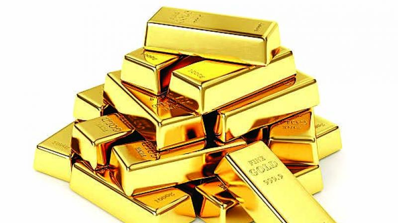 Spot gold for 24 Karat gold in Delhi was trading marginally lower by Rs 32 on stronger rupee and overnight fall in gold prices. The spot rupee was trading around 7 paise stronger against the dollar during the day, HDFC Securities Senior Analyst (Commodities) Tapan Patel said. (Photo: Representational)